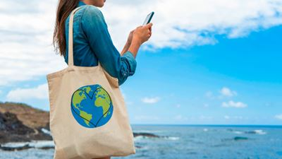 Woman with eco fabric bag and smartphone