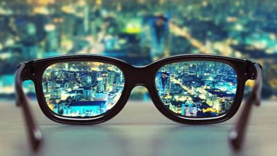 Glasses with city view reflection