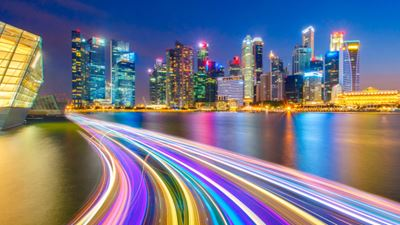 Landscape of the Singapore financial district and business building with speed light on the river