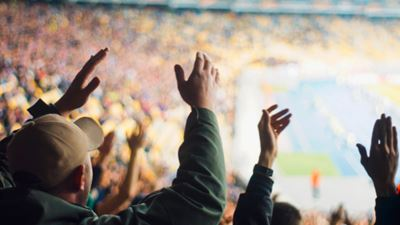 Football fans clapping on the podium of the stadium