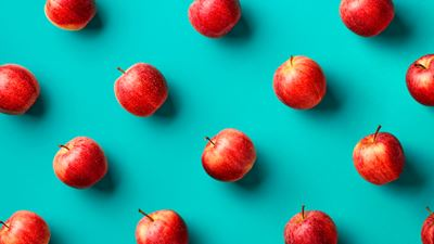 Fresh red apples on blue background