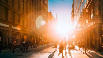 Helsinki, Finland. People Walking On Kluuvikatu Street In Winter Sunlight