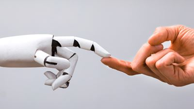 Robot Touching Human Finger Against Gray Background